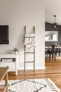 tidy living room with ladder as decoration tidy your house at the start of a new month