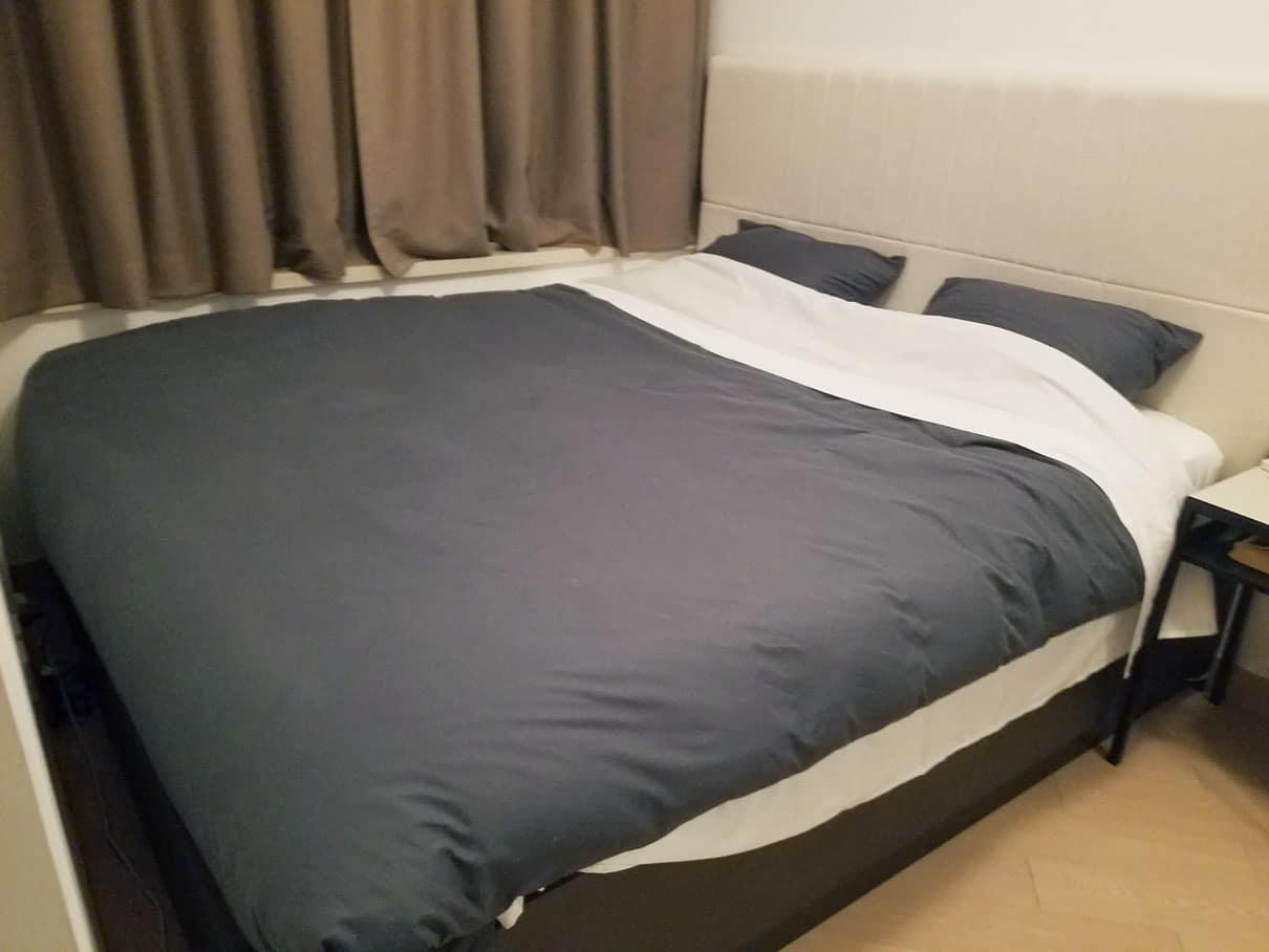 bed made with good quality bedlinen brooklinen declutter the bedroom