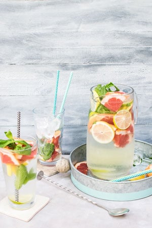 can and glasses of fruit infused water for your at home spa