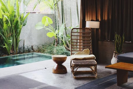 bali villa private pool and rattan chair ways to improve mood