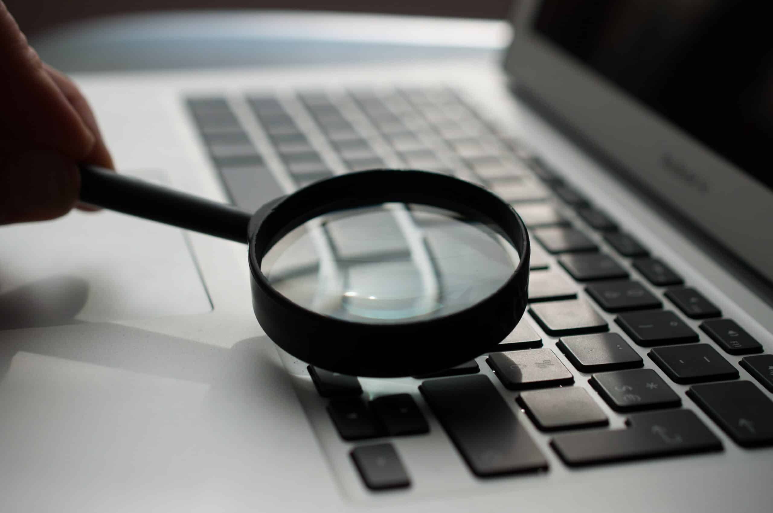 magnifying glass above laptop keyboard