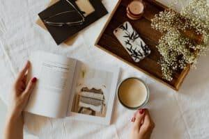 follow your dreams inspiring image of woman reading a book